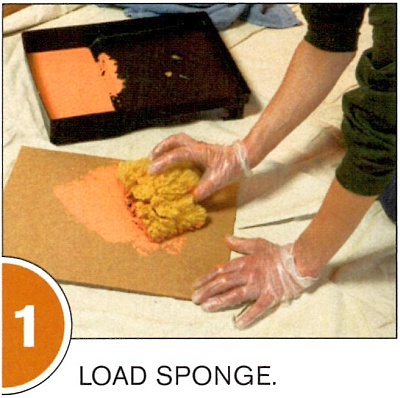 Remove excess glaze by blotting the sponge