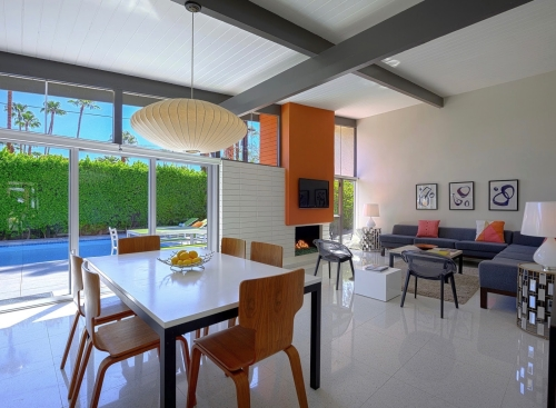 Open floor concept home painted a neutral color with orange accents