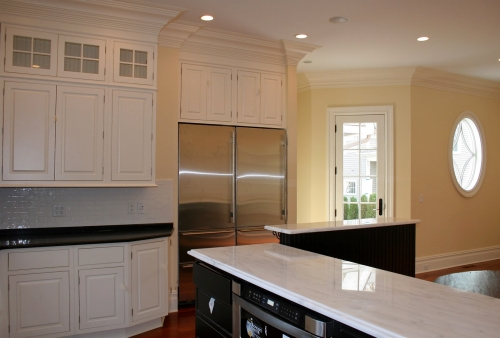 Kitchen and dining room painted a light, soft yellow