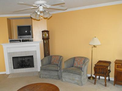 Our living room walls painted a yellow-tan color