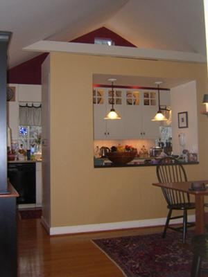 Open kitchen / dining room area painted different colors
