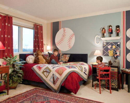 Kids' bedroom painted and decorated in blue and red
