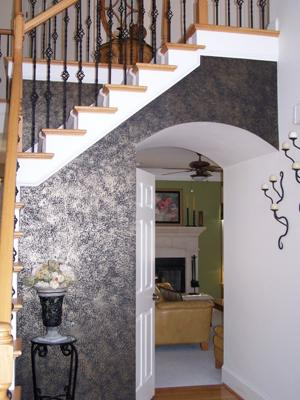 Black accent wall with a sponged-on finish