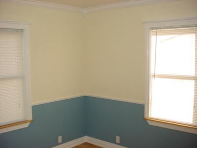 Walls Painted Soft Yellow and Muted Blue