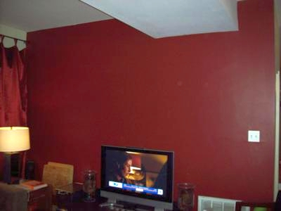 Living room wall painted a deep red color