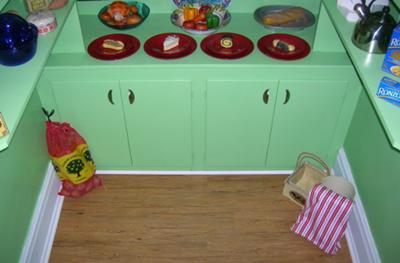 Another view of green painted cupboards