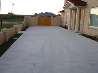 Another view of the driveway and landscaping