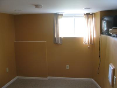Freshly painted orange bedroom in the basement
