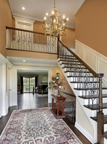 Contrast in colors makes large foyer walls look smaller