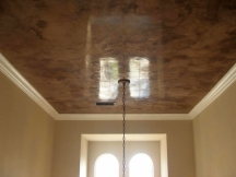 Burnished venetian plaster makes ceilings look like stone