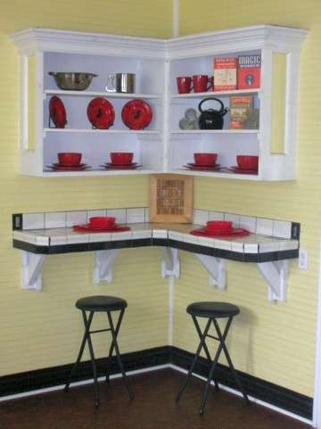 Bright yellow kitchen with red, white and black accents