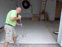Applying the first coat of epoxy paint