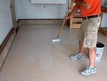 Applying protective sealer to the floor