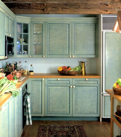 Shabby chic kitchen cabinets ragged off in butternut yellow and aqua blue for a vintage effect