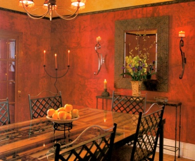 Rich red dining room walls painted with a ragged off finish