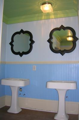 Example of colors, antique sinks, custom mirrors and pine wide plank flooring