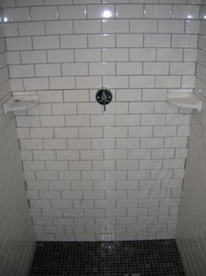 Custom mosiac tile floor and subway tiled shower pre grouting
