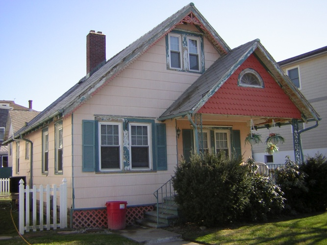 Before: peeling paint on Victorian cottage
