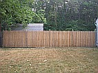 Bare fence in need of waterproofing