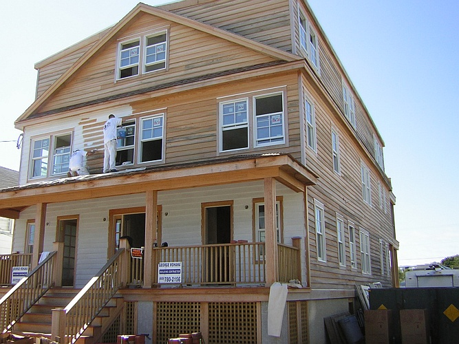 Before: bare wood siding and porch