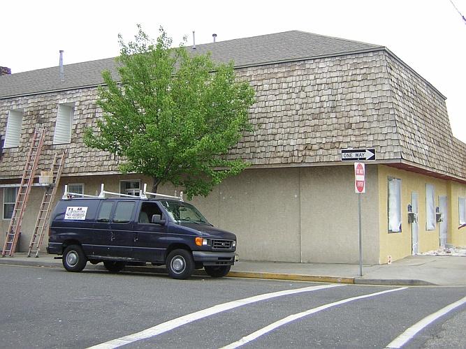 Before: bare wood roof shingles