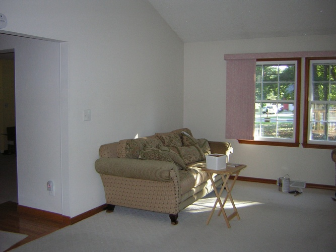 Before: blank walls in living room