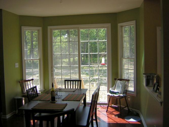 After: green paint color enhances flooring
