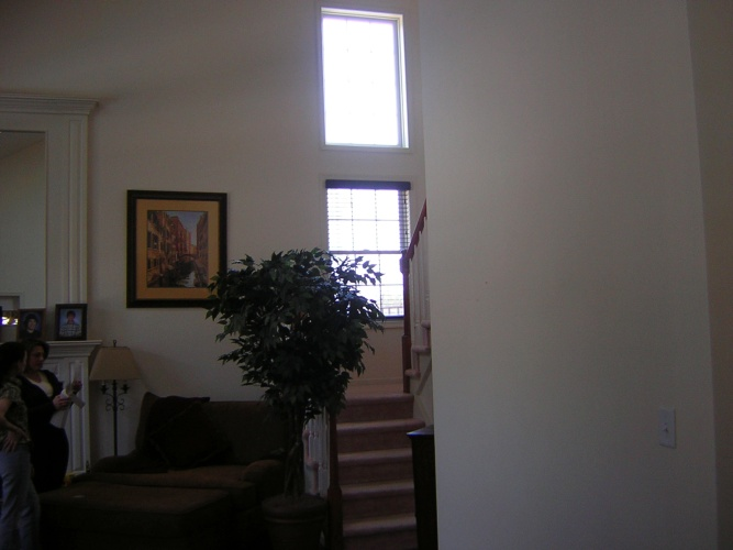 Before: spacious family room needs wall color