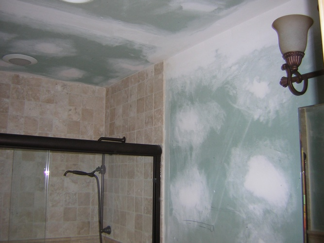 Before: unpainted drywall in shower