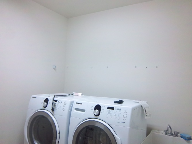 Before: boring unpainted laundry room