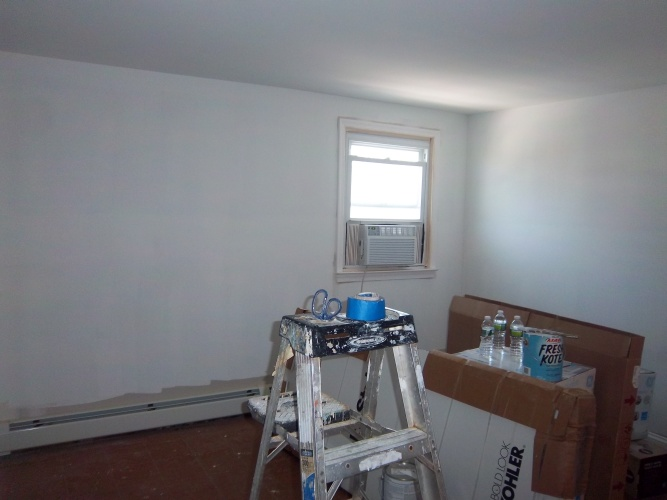 Before: unpainted walls in bedroom