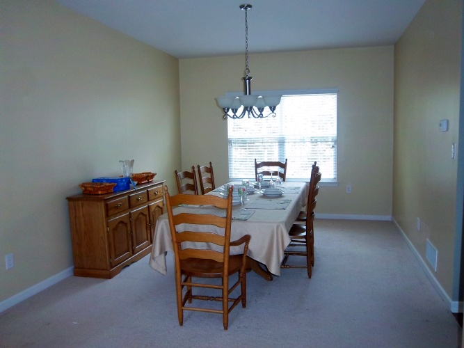 After: yellow wall paint is more inviting