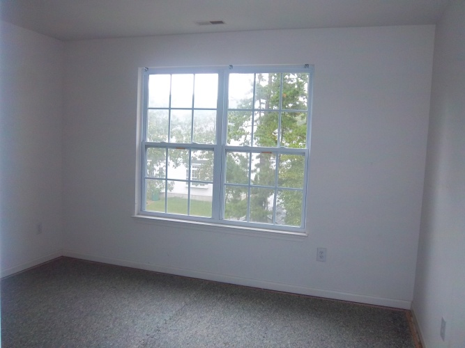 Before: unpainted dining room