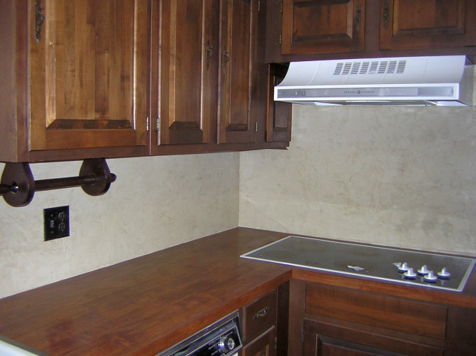 After: venetian plaster on backsplash looks like stone