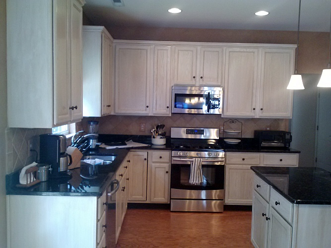 After: cabinets painted to look pickled