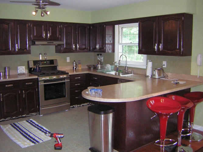 After: cabinets in bold deep color look chic