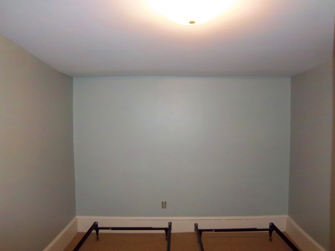 After: painted walls look more peaceful in bedroom