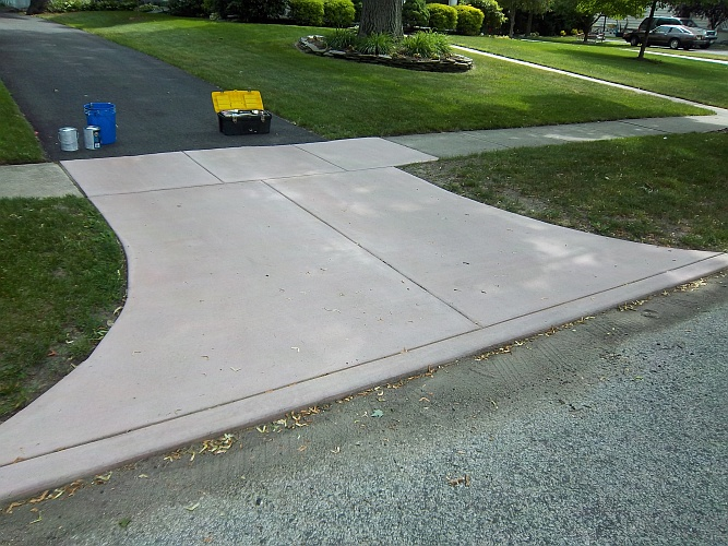 Before: pinkish concrete driveway