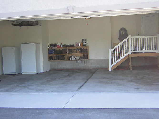 Before: typical unpainted garage floor