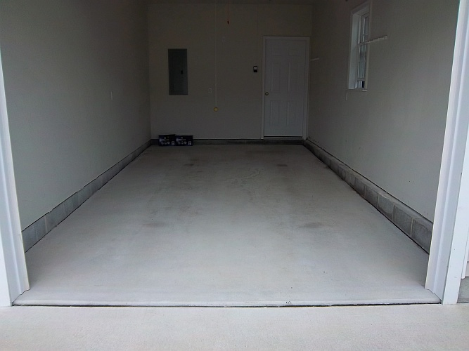 Before: bare concrete floor in garage