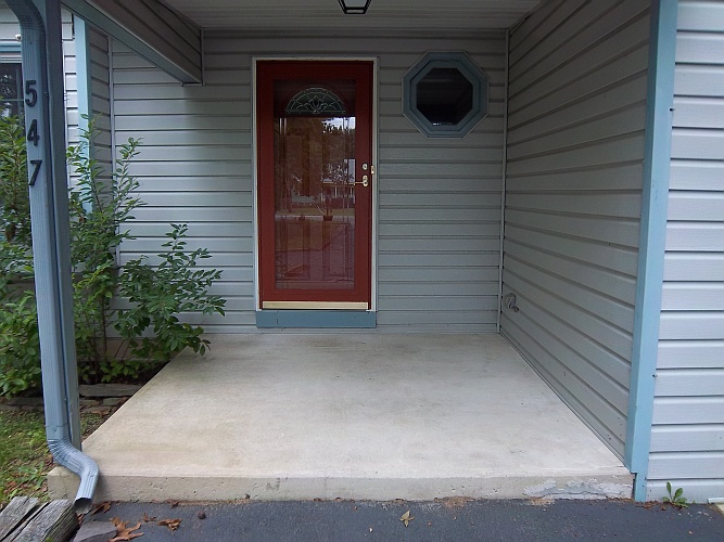Before: dirty concrete porch