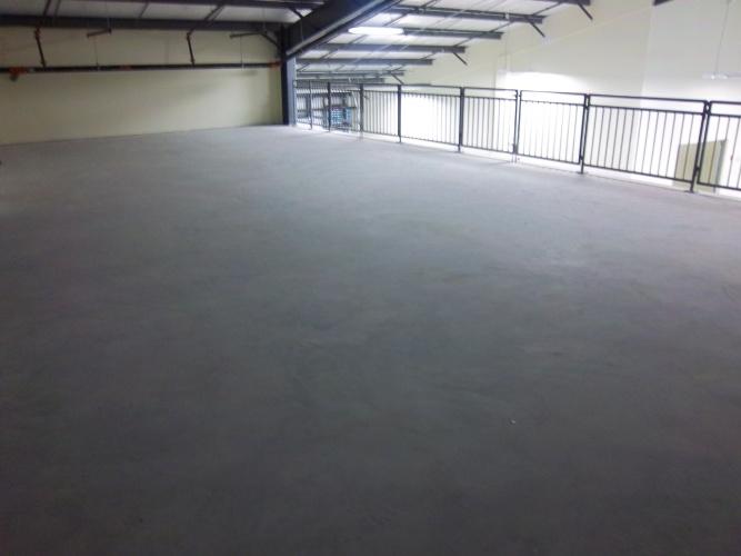 Before: unsealed concrete floor