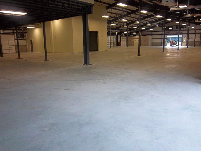 Before: bare unsealed concrete floor