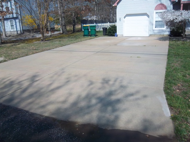 After: power washed driveway