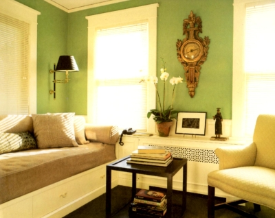 Yellow trim paired with warm green wall color