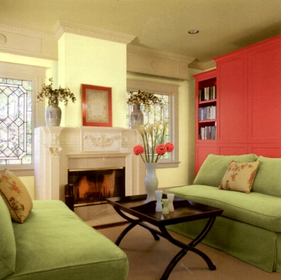Beige antique woodwork paired with bright yellow and pink wall colors