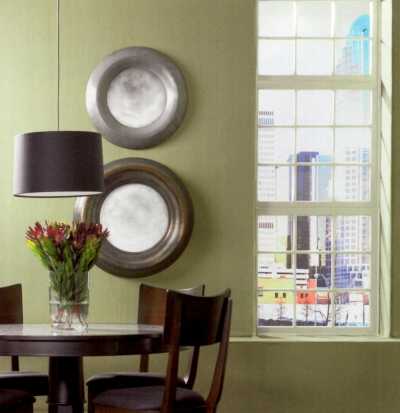 Green walls with tinted window trim in a dining room