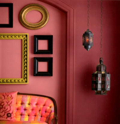 Deep pink trim and wall color with contrasting decor elements