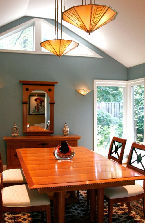 Contemporary dining room painted a muted blue-green color