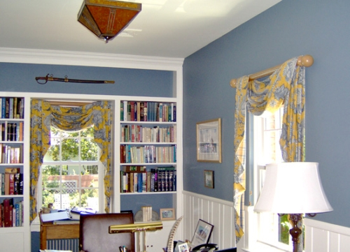 Home office with the upper walls painted a cloud blue color